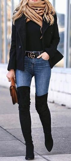 #winter #outfits black pea coat, brown scarf, black top, blue denim skinny jeans and black thigh-high heeled boots outfit