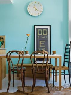 Blue wall, vintage chairs, simple decorations. Perfection!