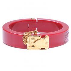 This is an authentic LOUIS VUITTON Lock Me Bracelet in Pomme D Amour.