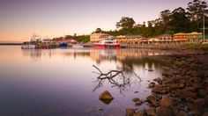 Strahan is a harbour-side village with a dark and fascinating convict past set on the edge of the Tasmanian Wilderness World Heritage Area. Tasmania, Wilderness, Places To Go, Past, Australia, River, World, Outdoor, Outdoors