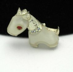 Hattie Carnegie Vintage Primitives on Parade White Figural Dog Pin Brooch. Purchase at http://stores.ebay.com/A-Touch-of-Rose-Vintage-Jewels