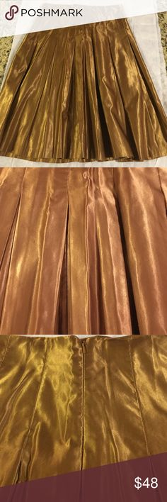 """Copper pleated shimmery skirt Made exclusively by Mark and Spencer , made in Morocco, U.K. Size 10, 67 % cotton, 33% polyamide. Waiste 14"""", length approx 25"""". Wore once to a wedding. Bundle up and save, bigger discounts on bigger bundles....😊🌲 Mark and spencer Skirts"""