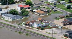 Flood waters rise in Buffalo, Thursday, July 3, 2014 as the crest approaches. (John Schultz, Quad-City Times)