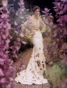 #Tim Walker  Again camera poking through some long flower stems around the gardens if there is anything suitable at the time could look cool!