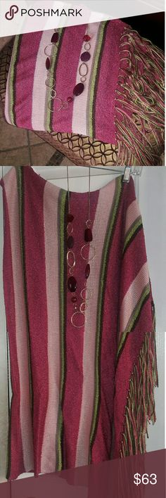 "Lane Bryant Diagonal  Pink & mauve Fringed Pancho Never worn pancho 34"" from shoulder fringe 42""  on the left side only. Front and back made the same .Feels really soft .  There's plenty of room .Bundle with pink velvet shoes and voila! Great outfit!!!  *** Necklace included*** there's not a hole in the poncho I wanted to show the fringe at the very bottom (photo was too large) Lane Bryant Sweaters Shrugs & Ponchos"