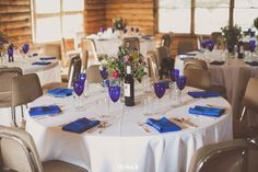 This is similar to how we will have the table setting. White plates, clear wine glasses, and accents of blue with the napkins, mason jars and flowers.