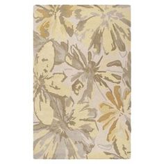 """Stylishly anchor your living room or master suite with this lovely hand-tufted wool rug, showcasing an artful multicolor floral motif.  Product: RugConstruction Material: 100% WoolColor: Butter, gold and gray  Features:  Hand-tuftedMade in IndiaFloral motif   Pile Height: 0.63""""  Note: Please be aware that actual colors may vary from those shown on your screen. Accent rugs may also not show the entire pattern that the corresponding area rugs have.Cleaning and Care: Vacuum regularly ..."""