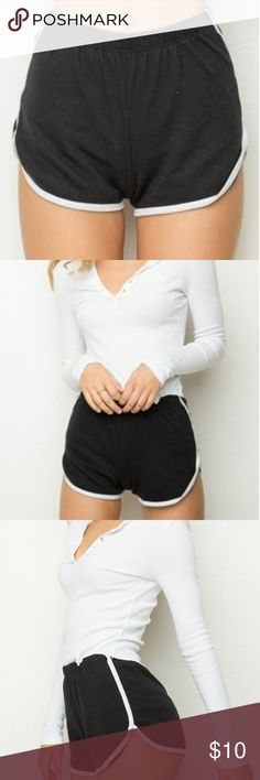Brandy Melville Lisette Shorts Retro style black shorts with white varsity stripe. Super soft material with elastic waist band. Used but in good condition. It's one size but fits xs-small. Brandy Melville Shorts