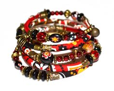 Red, black, yellow, white and bronze adjustable wrap bracelet with glass, velvet and handmade fabric beads on memory wire by PurpleTurtleStore on Etsy https://www.etsy.com/au/listing/195320790/red-black-yellow-white-and-bronze