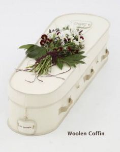 Cream Yorkshire wool coffin with embroidered name plate. Natural, sustainable and bio-degradable. Available from Natural Endings Funeral Services.