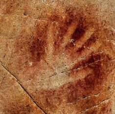 A 37,000-year-old hand stencil found in cave painting in Spain
