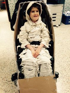 Mummy in a coffin costume for wheelchair.