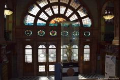 """The Sackville Street Building is a building on Sackville Street, Manchester, England. The University of Manchester occupies the building which, before the merger with UMIST in 2004, was UMIST's """"Main Building"""". Stained glass windows for a grand entrance from Sackville Street."""