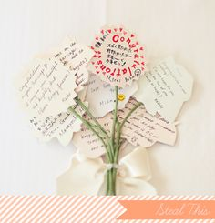 All of this bride's maids wrote sweet little congrats notes on paper flowers to make a little bouquet. This would make a super cute practice bouquet for the rehearsal, much more meaningful than a bow bouquet.