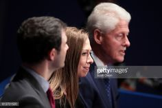 Former US President Bill Clinton daughter Chelsea Clinton and Marc Mezvinsky attend the town hall debate at Washington University on October 9 2016...