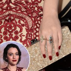 Kat Dennings perfectly matched her vampy lips and embroidered dress to her nail polish's bold hue at the Thor: The Dark World premiere.