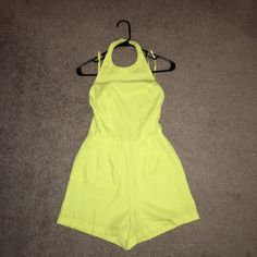 SALE! Halter Romper Sexy! Neon yellow romper. Halter neckline with button closure at neck. European size 6, which is equivalent to XS (US). Still new with tags! Not from listed brand, only did so for exposure. From LF. Nasty Gal Pants Jumpsuits & Rompers