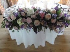 Long arrangement on the table at Bury Court.