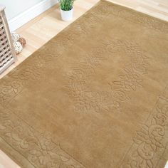 Sculptured Floral design in a plain colour. #FloralRugs #DecorTips