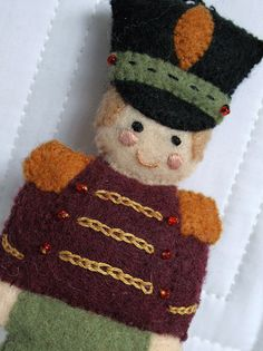 A cute tin soldier made of felt for the Christmas tree... Sure to make you smile!   :)