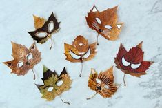 Make these quick and easy woodland animal and superhero leaf masks using pressed and dried autumn leaves and felt tip pens.