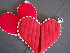 Heart Hot Pad. If you are looking for a homemade Valentine's Day gift this Heart Hot Pad is a great match. Learn how to make a hot pad with this easy sewing tutorial. Decorate your heart with ric rac trim and topstitching for a look you'll love. It's a perfect gift for someone who loves to cook!
