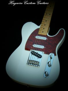 http://www.haywirecustomguitars.com Haywire Custom ShopCustom Modified Classic White Solid Alder body + Haywire Custom Guitar Shop Modifications with Fender Tuners, New Finish and Upgraded with Neck and Middle SRV pickups! ALSO ADDED free:Comes with a built in Treble Bleed Circuit.