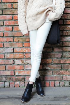 white sweater, white cuffed skinny jeans, black heals, and black sholder bag