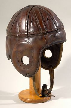 "Spalding leather football helmet c.1920s. Early leather helmet with ""Spalding"" logo and ""ZH"" model designation stamped at front center. $475"