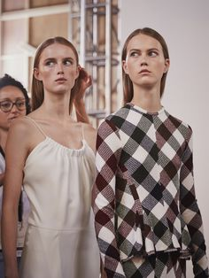 The designer brings minimalist femininity to NYFW – with clean-cut lines, flowing white and graphic check prints Victoria Beckham SS16 backstage