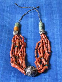 Necklace. Recent assamblage of antique beads: coral branch, amazonite, amber, silver and glass.