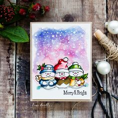 I loved watercoloring these snowmen from the Art Impressions Holly Jolly set with Distress Inks.