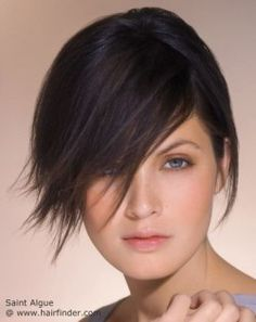 Short smooth hair with bangs that fall across the face.