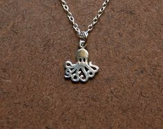 TIny sterling silver octopus charm necklace. $24.00, via Etsy.