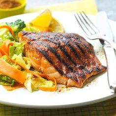 Chili powder, cumin, and brown sugar make a sweet and savory rub for this grilled salmon main dish recipe.