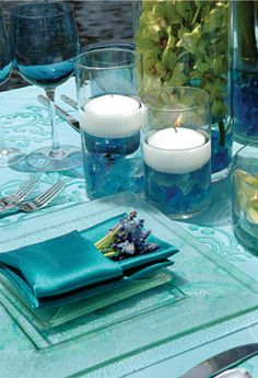 Blue stones in bottom of glass, then some white calla lilies could go in there