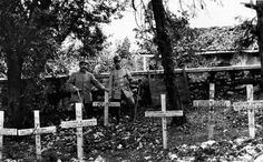 Near the castle of Rubbia two soldiers standing beside the tombs of the Italian and Austrian fallen comrades Savogna d'Isonzo 1916