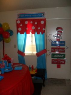 "Seuss- for party, could make these ""curtains"" out of cheap plastic table cloths. Add white paper dots to the top. Easy 1 time use over window or behind food/dessert table. Also- love the balloon tree in the corner"