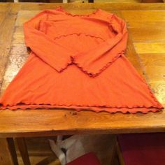 """Long sleeve orange dress. Adorable orange dress with subtle frills long hem, sleeves, neckline, sides, and bust. I am 5'9"""" and it comes about mid thigh to getting close to my knee. Don't hesitate to ask questions or make an offer! Treehouse 28 Dresses"""