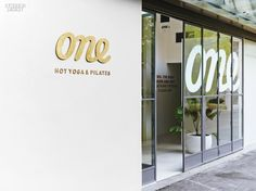 Say Om to Sydney's One Hot Yoga & Pilates by Rob Mills | Brass signage…
