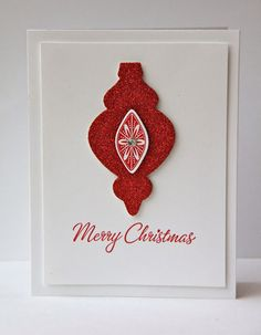 "handmade Christmas card from Ladybug Designs: Clean and Simple Christmas ... elegant look with lots of white space ... ornament die cut from red glimmer paper ... luv the handwriting script font for the ""Merry Christmas"" ..."