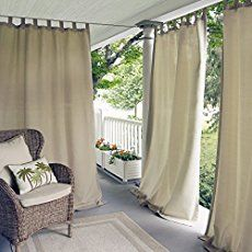 Making your own outdoor curtain panels from drop cloths is easy, attractive and gives your porch some nice shade - and ambiance, too!