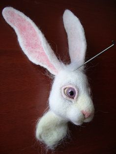 tutorial for a needle felted rabbit - written in Russian, but good photos.
