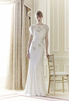 Beaded modest wedding dress with flutter sleeve