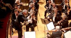 Music director's contract extended on eve of first international tour