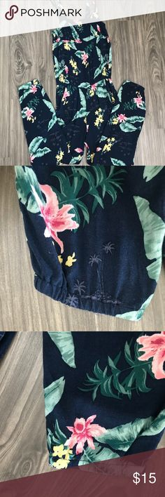 H&M L.O.G.G. Girl's Floral Jumpsuit size 14Y Pre-owned. In great condition. No rips or stains. Pretty floral pattern. Shirred top and waist for flexibility of sizing. Elastic detail at bottom of pants. Double straps. See pics for details. Feel free to ask me questions.  Laid flat: Measures approximately 13.5 inches across from pit to pit but can be stretched more, 12 inches across at waist but can be stretched more, and 27 inches inseam.  100% viscose. H&M Bottoms Jumpsuits & Rompers