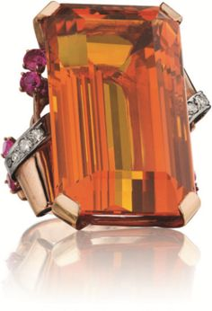 Retro Citrine, Diamond and Ruby Ring - Set with a rectangular cut-cornered citrine, weighing approx 53.00 carats, with scrolling shoulders accented with pavé-set diamonds and circular-cut ruby, mounted in 14K rose gold.