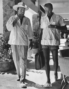 John Wayne and Gary Cooper vacationing in Acapulco, Mexico, ca. 1940s. Picture copyright Phil Stern.