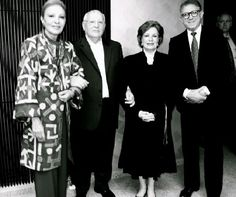 Mr.Gorbachev holding arms with the Empress of Iran and Mrs. Sadat of Egypt