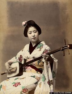 """1885: A geisha plays the shamisen, a three-stringed instrument."" - Found via Buzzfeed"